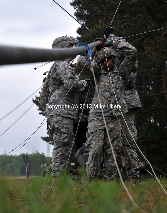 Bravo Battery, 1/134th Field Artillery, based in Piqua, Ohio, during a day of firing their 105mm howitzer cannons at Camp Grayling, Michigan. The unit was taking part in their two-week annual training. The day began for the soldiers with a 0615 muster to convoy to the firing range and ended after the soldiers arrived back at camp after their final fire mission of the day at 2300 hours.