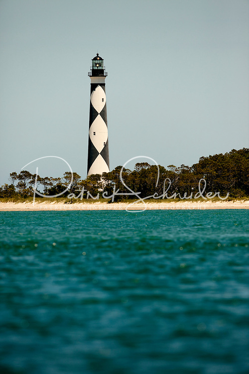 The black-and-white diamond painted Cape Lookout Lighthouse in the Southern Outer Banks of North Carolina is one of the country's most eye-catching lighthouse designs. The black diamonds point in a north-south direction, while the white diamonds point east-west. The checkered daymarker is intended to show direction. The 163-foot high Cape Lookout Lighthouse is one of the few lighthouses that operate during the day. Charlotte NC photographer Patrick Schneider has extensive photo collections of the following lighthouses: Bodie Island Lighthouse, Bald Head Island Lighthouse, Cape Fear Lighthouse, Cape Hatteras Lighthouse, Cape Lookout Lighthouse, Currituck Beach Lighthouse, Diamond Shoal Lighthouse, Federal Point Lighthouse, Oak Island Lighthouse, and Ocracoke Lighthouse on Ocracoke Island.