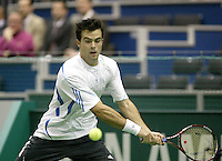 24-2-06, Netherlands, tennis, Rotterdam, ABNAMROWTT, Daniele Bracciali in action against Nikolay Davydenko