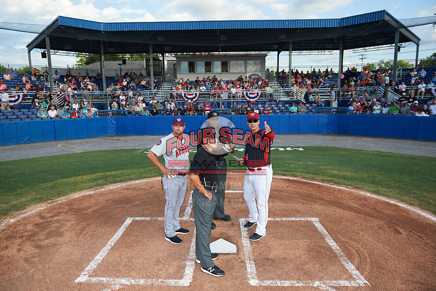 Batavia Muckdogs manager Mike Jacobs (28) goes over the ground rules with umpires Dexter Kelley, Kelvis Velez, and manager Jerad Head (left) during the lineup exchange before a game against the Auburn Doubledays on June 19, 2017 at Dwyer Stadium in Batavia, New York.  Batavia defeated Auburn 8-2 in both teams opening game of the season.  (Mike Janes/Four Seam Images)