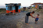 A woman plays with her child in the largely Roma neighborhood of Gorno Ezerovo, part of the Bulgarian city of Burgas. Residents here don't self-identify much as Roma, because of the negative connotations associated with the word, so many refer to themselves as a Turkish-speaking minority.