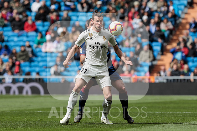 Real Madrid's Gareth Bale and SD Eibar's Jose Angel Valdes 'Cote' during La Liga match between Real Madrid and SD Eibar at Santiago Bernabeu Stadium in Madrid, Spain.April 06, 2019. (ALTERPHOTOS/A. Perez Meca)