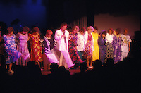 A Don Ho show with line of women dancing on stage at his evening Waikiki performance