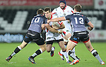 No way through for Ulster fullback Louis Ludik as Ospreys pair Dan Biggar and Ashley Beck close the gap.<br /> Guiness Pro12<br /> Ospreys v Ulster<br /> 20.12.14<br /> ©Steve Pope -SPORTINGWALES