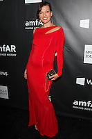 HOLLYWOOD, LOS ANGELES, CA, USA - OCTOBER 29: Milla Jovovich arrives at the 2014 amfAR LA Inspiration Gala at Milk Studios on October 29, 2014 in Hollywood, Los Angeles, California, United States. (Photo by Celebrity Monitor)