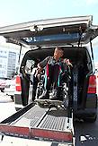 KAZ / Kasachstan / Pavlodar / 25.07.213 / Der querschnittgelähmte Georgij Tschetverikov fährt mit dem Rollstuhl aus seinem behindertengerecht umgebauten Minivan. Chetverikov ist nach einem Badeunfall querschnittsgelähmt / 61 years old tetraplegic Georgy Chetverikov maneuvering in his electric wheelchair out of his wheelchair accessible vehicle. He is handicapped after a swimming accident at the age of 18.