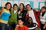 High school group of boys and girls posing in corridor between classes.