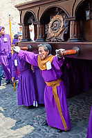 Antigua, Guatemala.  A Cucurucho Leads a Religious Procession through Antigua's Streets.