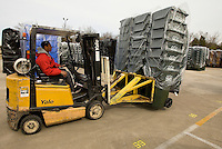 A worker drives a forklift carrying plastic garbage cans at SSI Schaefer plastic manufacturing in Charlotte, NC.