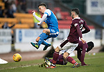 St Johnstone v Hearts…23.12.17…  McDiarmid Park…  SPFL<br />Stefan Scougall is stopped by Prince Buaben and Michael Smith<br />Picture by Graeme Hart. <br />Copyright Perthshire Picture Agency<br />Tel: 01738 623350  Mobile: 07990 594431
