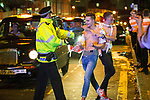 "© Joel Goodman - 07973 332324 . 16/11/2015 . Manchester , UK . Police push people back from the path of oncoming taxis . Annual student pub crawl "" Carnage "" at Manchester's Deansgate Locks nightclubs venue . The event sees students visit several clubs over the course of an evening . This year's theme is "" Animal Instinct - unleash your beast "" . Photo credit : Joel Goodman"