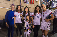 PASADENA, CA - AUGUST 4: Megan Rapinoe #15 and Julie Ertz #8 pose with the family of Gianni Infantino during a game between Ireland and USWNT at Rose Bowl on August 3, 2019 in Pasadena, California.