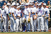 Florida Gators pregame huddle before Game 11 of the NCAA College World Series on June 19, 2015 at TD Ameritrade Park in Omaha, Nebraska. The Gators defeated Virginia 10-5. (Andrew Woolley/Four Seam Images)