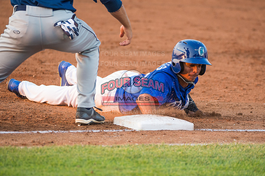 Kelvin Ramos (8) of the Ogden Raptors dives safely back to first base in action against the Helena Brewers in Pioneer League play at Lindquist Field on August 19, 2015 in Ogden, Utah.Ogden defeated Helena 4-2. (Stephen Smith/Four Seam Images)