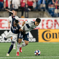FOXBOROUGH, MA - JULY 18: Luis Caicedo #27 and Fredy Montero #12 battle for the ball during a game between Vancouver Whitecaps and New England Revolution at Gillette Stadium on July 18, 2019 in Foxborough, Massachusetts.
