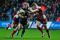 Friday 03 January 2014<br /> Pictured: Richard Fussell charges though the Scarlets Backs <br /> Re: Ospreys v Scarlets, Rabo Direct Pro 12 match at the Liberty Stadium Swansea, Wales