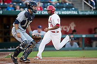 Xavier Scruggs (15) of the Springfield Cardinals crosses home plate during a game against the Northwest Arkansas Naturals at Hammons Field on August 20, 2013 in Springfield, Missouri. (David Welker/Four Seam Images)