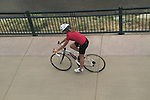 Woman riding herbike on a sidewalk in Denver, Colorado. .  John offers private photo tours in Denver, Boulder and throughout Colorado. Year-round.