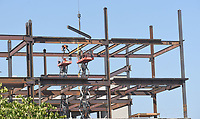 BEAM ME UP<br />Workers place steel Tuesday July 27 2021 on a building going up along West Northgate Road in Rogers, near the Rogers Convention Center. Go to nwaonline.com/210728Daily/ to see more photos.<br />(NWA Democrat-Gazette/Flip Putthoff)