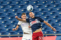 FOXBOROUGH, MA - AUGUST 7: Nick O'Callaghan #72 of Orlando City B and Tiago Mendonca #33 of New England Revolution II battle for head ball during a game between Orlando City B and New England Revolution II at Gillette Stadium on August 7, 2020 in Foxborough, Massachusetts.