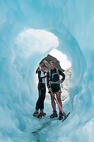 Tourist in ice cave on Franz Josef Glacier, Westland NP, West Coast, New Zealand