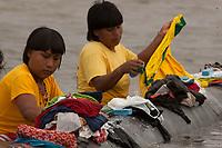 XI Jogos dos Povos Indígenas -  <br /> Mulheres Xavantes lavam roupa a beira do rio Tocantins durante os jogos indígenas.<br /> O evento, que acontece entre os dias 5 e 12 de novembro, tem como sede o município tocantinense de Porto Nacional, que fica a cerca de 60km da capital, Palmas. São sete dias de competições e apresentações culturais, com a participação de cerca de 1.300 indígenas, de aproximadamente 35 etnias, vindas de todas as regiões do país. São esperados ainda líderes e observadores indígenas de outros países (Argentina, Austrália, Bolívia, Canadá, Equador, EUA, Guiana Francesa, Peru e Venezuela). <br /> Foto Paulo Santos<br /> 08/11/2011<br /> Ilha de Porto Real, Porto Nacional, Brasil