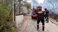 Forest fire in the Agioi Apostoloi village near Kalamos, Greece. 23 July 2018