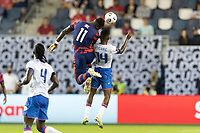 KANSAS CITY, KS - JULY 11: Daryl Dike #11of the United States heads a ball past Leverton Pierre #14 of Haiti during a game between Haiti and USMNT at Children's Mercy Park on July 11, 2021 in Kansas City, Kansas.