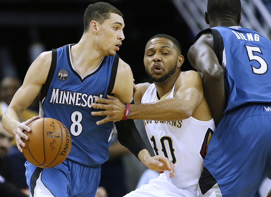Minnesota Timberwolves guard Zach LaVine (8) drives with the ball as center Gorgui Dieng (5) sets a pic on New Orleans Pelicans guard Eric Gordon (10) during the first half of an NBA basketball game Saturday, Feb. 27, 2016, in New Orleans. (AP Photo/Jonathan Bachman)
