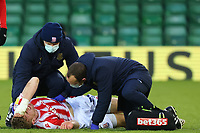 13th February 2021; Carrow Road, Norwich, Norfolk, England, English Football League Championship Football, Norwich versus Stoke City; Nathan Collins of Stoke City receives medial treatment for a leg injury