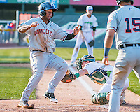 31 July 2016: Connecticut Tigers infielder Junnell Ledezma avoids a tag at the plate to score against the Vermont Lake Monsters at Centennial Field in Burlington, Vermont. The Lake Monsters edged out the Tigers 4-3 in NY Penn League action.  Mandatory Credit: Ed Wolfstein Photo *** RAW (NEF) Image File Available ***