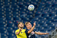 FOXBOROUGH, MA - OCTOBER 3: Walker Zimmerman #25 of Nashville SC and Adam Buksa #9 of New England Revolution battle for head ball during a game between Nashville SC and New England Revolution at Gillette Stadium on October 3, 2020 in Foxborough, Massachusetts.