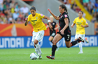 Shannon Boxx (r) of team USA and Cristiane of team Brazil during the FIFA Women's World Cup at the FIFA Stadium in Dresden, Germany on July 10th, 2011.
