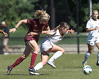 Boston College defender Madison Meehan (14) attempts to control the ball as Virginia Tech midfielder Kelsey Loupee (9) defends.Virginia Tech (maroon) defeated Boston College (white), 1-0, at Newton Soccer Field, on September 22, 2013.