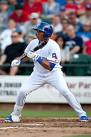 Round Rock Express center fielder Leonys Martin #27 prepares to bunt during the MLB exhibition baseball game against the Texas Rangers on April 2, 2012 at the Dell Diamond in Round Rock, Texas. The Rangers out-slugged the Express 10-8. (Andrew Woolley / Four Seam Images).