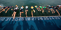 29 JUN 2014 - CHICAGO, USA - Competitors dive into the water at the start of the elite men's ITU 2014 World Triathlon Series round in Grant Park in Chicago in the USA (PHOTO COPYRIGHT © 2014 NIGEL FARROW, ALL RIGHTS RESERVED)
