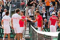 15-09-12, Netherlands, Amsterdam, Tennis, Daviscup Netherlands-Suisse, Doubles, Robin Haase/Jean-Julian Rojer (L) receiving congretulations from Roger Federer/Stanislas Wawrinka.