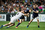 Glenn Bryce of Scotland is tackled by Charlton Kerr of England during their Pool C match between England and Scotland as part of the HSBC Hong Kong Rugby Sevens 2018 on 06 April 2018, in Hong Kong, Hong Kong. Photo by Marcio Rodrigo Machado / Power Sport Images