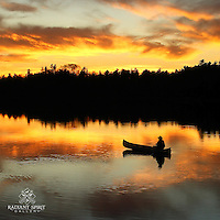 """""""Sunset Paddle""""<br /> The canoeist enjoys a sunset paddle on a beautiful Fall evening in the Boundary Waters Canoe Area Wilderness (BWCAW). The silhouette of the canoeist effortlessly gliding along the river illustrates the peace and serenity we relish in the Boundary Waters."""