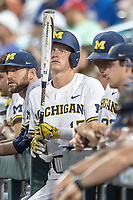 Michigan Wolverines first baseman Jimmy Kerr (15) waits in the dugout against the Vanderbilt Commodores during Game 2 of the NCAA College World Series Finals on June 25, 2019 at TD Ameritrade Park in Omaha, Nebraska. Vanderbilt defeated Michigan 4-1. (Andrew Woolley/Four Seam Images)