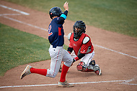 Batavia Muckdogs catcher Pablo Garcia (4) tags Korby Batesole (12) out at home during a game against the Lowell Spinners on July 15, 2018 at Dwyer Stadium in Batavia, New York.  Lowell defeated Batavia 6-2.  (Mike Janes/Four Seam Images)