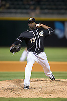 Charlotte Knights relief pitcher Onelki Garcia (13) in action against the Columbus Clippers at BB&T BallPark on May 27, 2015 in Charlotte, North Carolina.  The Clippers defeated the Knights 9-3.  (Brian Westerholt/Four Seam Images)