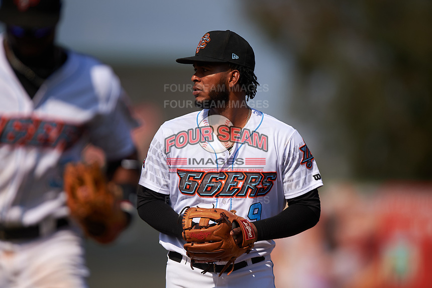 Inland Empire 66ers third baseman Alberto Triunfel (9) jogs off the field between innings of a California League game against the Lancaster JetHawks at San Manuel Stadium on May 20, 2018 in San Bernardino, California. Inland Empire defeated Lancaster 12-2. (Zachary Lucy/Four Seam Images)