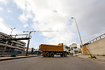 A picture taken shows a truck block the road during a protest against the increase in prices of consumer goods and the crash of the local currency, in Beirut, Lebanon, March 16, 2021. Scattered protests broke out on Tuesday in different parts of the country after the Lebanese pound hit a new record low against the dollar on the black market. Photo by Marwan Bou Haidar