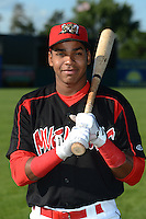 Batavia Muckdogs outfielder Wildert Pujols (15) poses for a photo before a game against the Williamsport Crosscutters on September 4, 2013 at Dwyer Stadium in Batavia, New York.  Williamsport defeated Batavia 6-3 in both teams season finale.  (Mike Janes/Four Seam Images)