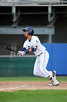 Princeton Rays first baseman Carlos Vargas (25) follows through on a swing during the first game of a doubleheader against the Greeneville Reds on July 25, 2018 at Hunnicutt Field in Princeton, West Virginia.  Princeton defeated Greeneville 6-4.  (Mike Janes/Four Seam Images)