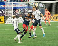 FOXBOROUGH, MA - OCTOBER 19: Andrew Farrell #2 of New England Revolution and Kacper Przybylko #23 of Philadelphia Union compete for a high ball during a game between Philadelphia Union and New England Revolution at Gillette on October 19, 2020 in Foxborough, Massachusetts.