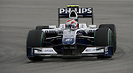 05 Apr 2009, Kuala Lumpur, Malaysia ---  AT&T Williams driver Kazuki Nakajima of Japan steers his carduring the 2009 Fia Formula One Malasyan Grand Prix at the Sepang circuit near Kuala Lumpur. Photo by Victor Fraile --- Image by © Victor Fraile / The Power of Sport Images