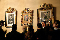 Tourists at the Dolmabahce Palace, Istanbul, Turkey, looking at Ottoman portraits