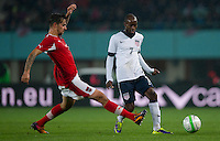 VIENNA, Austria - November 19, 2013: DaMarcus Beasley and Austria's Martin Harnik during a 0-1 loss to host Austria during the international friendly match between Austria and the USA at Ernst-Happel-Stadium.